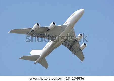 Airbus A380 fly-by. Clear blue sky. - stock photo