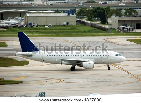 Airbus A-319 on runway in Ft lauderdale - stock photo