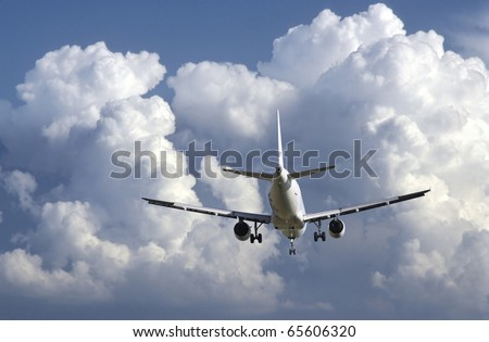 Airbus plane landing as storm is coming. - stock photo