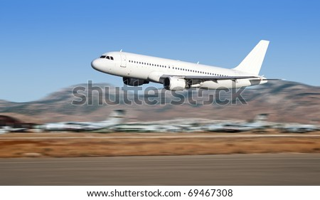 Airbus plane taking off on Athens airport. - stock photo
