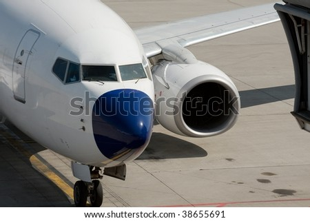 Aircraft arriving at the airport - stock photo