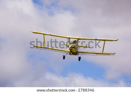 Aircraft-Crop duster spraying fields with chemical insecticides to prevent spoilage - stock photo