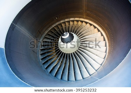 Aircraft engine close-up. The fan and turbine blades of modern passenger plane.