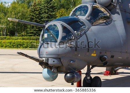aircraft gun installed on Russian military helicopter - stock photo