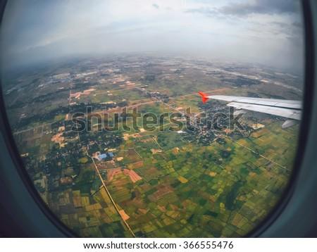 Aircraft illuminator window view, Bangkok ,Thailand  - stock photo