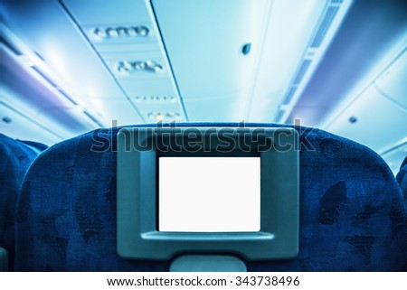 Aircraft monitor in passenger seat - stock photo