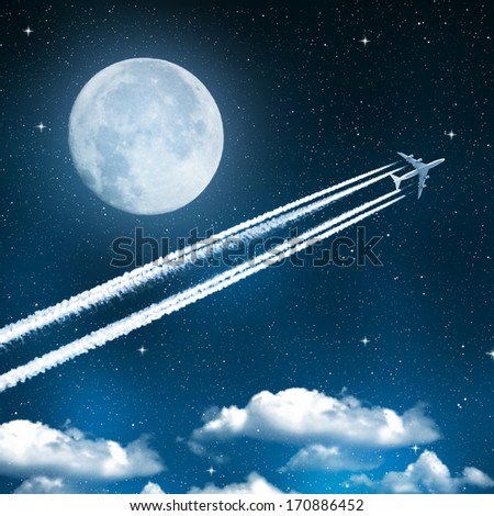 aircraft on night sky with moon  - stock photo