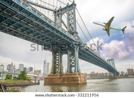 Aircraft overflying New York City skyline.