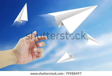 Aircraft paper hand blue sky winner crash success business - stock photo
