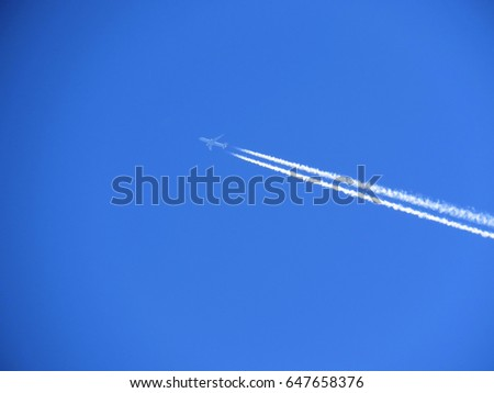 Aircraft Vapor trail in a perfect blue sky
