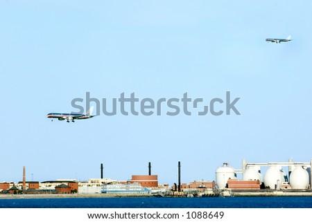 Aircrafts preparing for landing at Logan airport. Boston. - stock photo