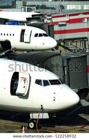 Aircrafts ready for boarding, near terminal - stock photo