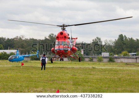 "Airfield ""Black"", MOSCOW REGION, RUSSIA - JUNE 11, 2016: The championship of Russia on helicopter sports. Helicopter Mi-2 take off"