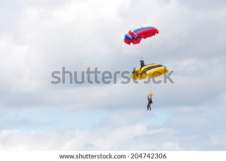 "Airfield Frolovo,Russia - June 29,2014.Festival ""Wings of Parma 2014"".air element shelves parachutists in air"