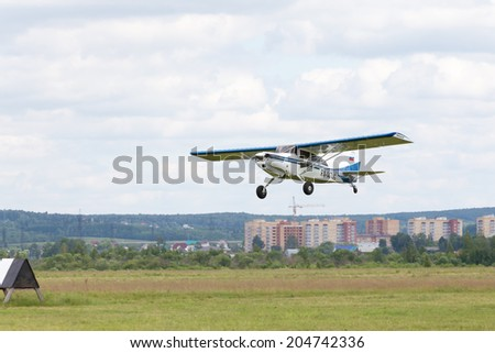 "Airfield Frolovo,Russia - June 29,2014.Festival ""Wings of Parma 2014"".Maule plane soars in sky"