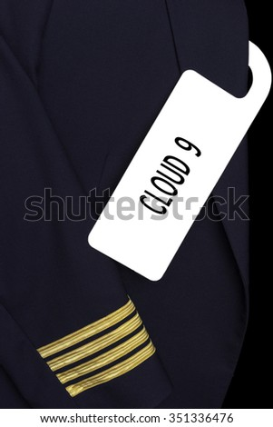 Airline Captain uniform with a tag. CLOUD NINE 9