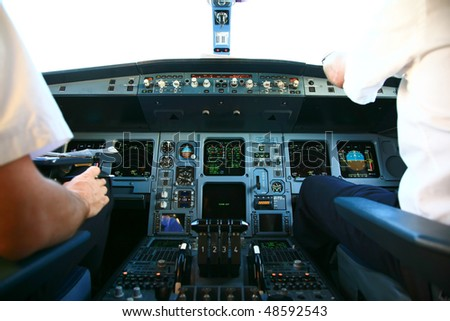 airline jet cockpit before takeoff - stock photo
