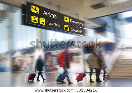 Airline passengers at the Airport.  - stock photo