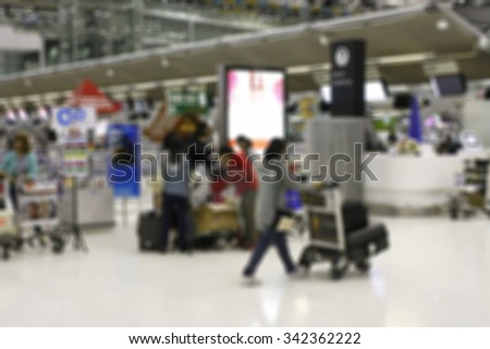 Airline Passengers in an International Airport. - stock photo