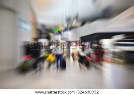 Airline Passengers in an International Airport motion blur - stock photo