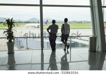 Airline passengers silhouettes at airport - stock photo