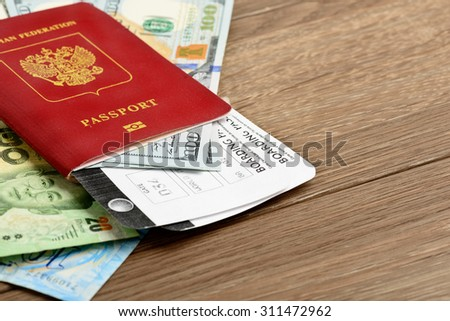 Airline tickets and documents on wooden table - stock photo