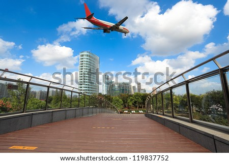 airliner and footbridge with modern building in shanghai north bund - stock photo
