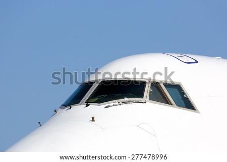 Airliner cockpit windows - stock photo