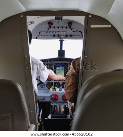 Airliner cockpit with two pilots - stock photo