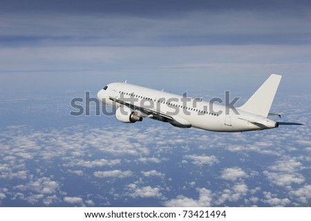 airliner flying in a cloudy sky - stock photo