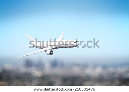airliner flying over the city - stock photo