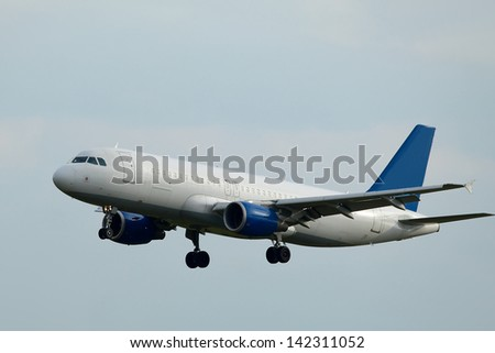 Airliner landing on final approach - stock photo