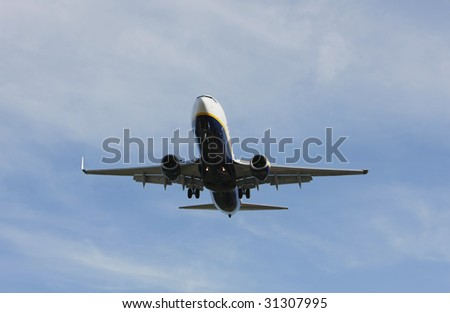 Airliner Makes its Landing Approach with a blue sky