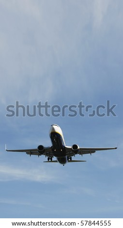 Airliner Makes its Landing Approach with a blue sky - stock photo