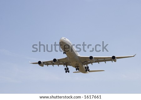 Airliner on final approach at Portland International Airport - stock photo