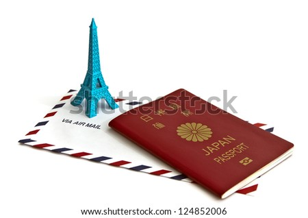 airmail envelope and passport on white - stock photo