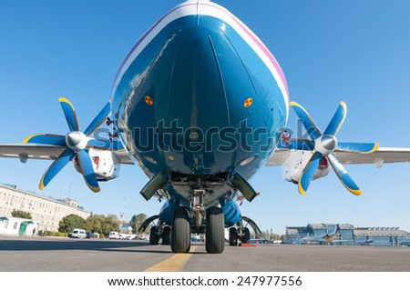 Airplane AN-24 stay in airport.  View from below. closely - stock photo