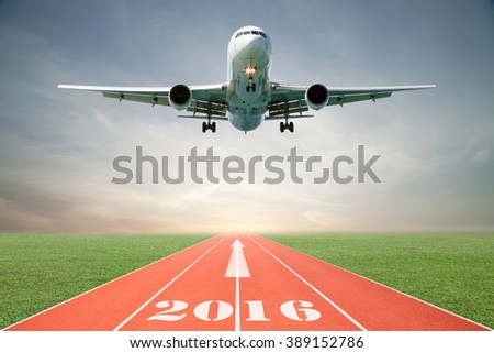 Airplane and Running track with green grass and blue sky white cloud - stock photo
