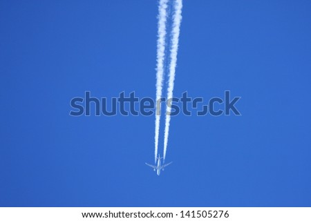airplane and vapour trail - stock photo