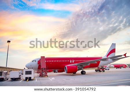 Airplane at airport in the colorful sunrise.  - stock photo