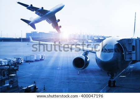Airplane at the terminal gate , Modern international airport during sunset - Concept of freight cargo plane in transport and import-export commercial logistic ,shipping business industry  - stock photo