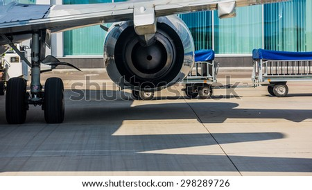 Airplane at the terminal gate preparing the takeoff. Concept of alternative lifestyle and permanent traveling around the world - stock photo