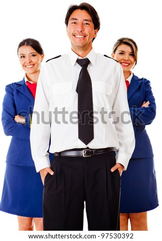Airplane cabin crew with pilot and air hostesses - isolated over white - stock photo