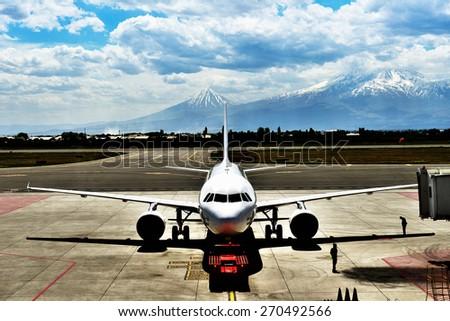 Airplane close to gate bridge, retro filter - stock photo