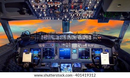airplane cockpit Flight Deck in sunset - stock photo