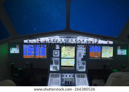 airplane cockpit interior view in the night airline - stock photo