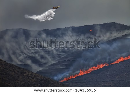 Airplane firefighter in Syros island Greece - stock photo