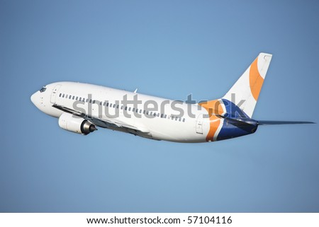 airplane flying against a blue sky - stock photo