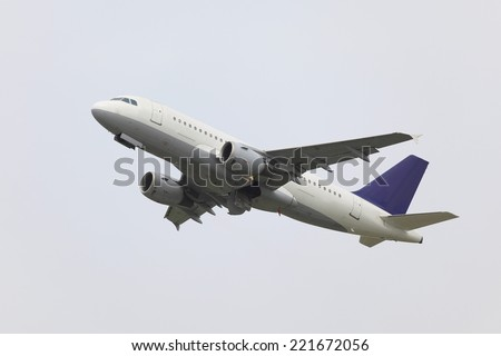 Airplane flying away to the blue sky - stock photo
