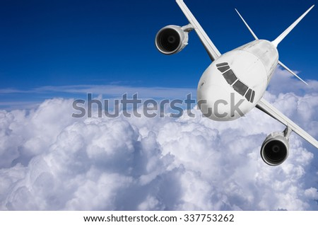Airplane flying high above the clouds. - stock photo